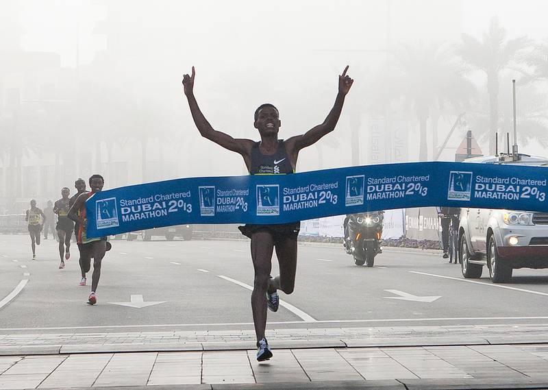 Dubai, United Arab Emirates, Jan 25 2013, 2013 Standard Chartered Dubai Marathon, - (centre) Elite runner Desisa benti Lelisa crosses the finish line at the Standard Chartered Dubai Marathon, Jan 25, 2013.  Mike Young / The National