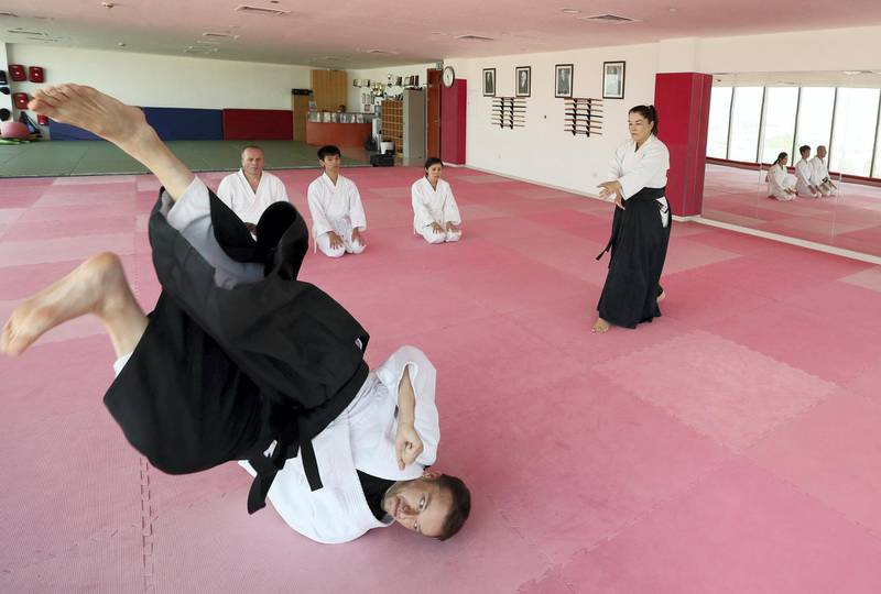 Dubai, United Arab Emirates - July 20, 2019: Cathy Darnell with Vladimir Bojovic. Cathy Darnell is the only female Aikido instructor in Dubai and is a 4th dan, she has the oldest dojo in the country, Zanshinkan Aikido club Dubai is celebrating our 25th anniversary in 2020. Saturday the 20th of July 2019. Al Barsha, Dubai. Chris Whiteoak / The National