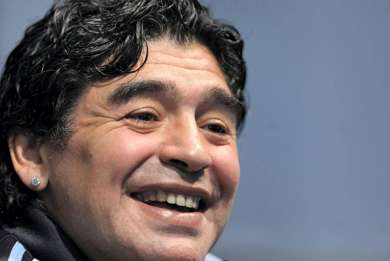 (FILES) In this file picture taken on January 16, 2009 Argentina's national football team coach Diego Maradona laughs during a press conference in Ezeiza, Buenos Aires. Argentine football legend Diego Maradona turns 60 on October 30, 2020.   / AFP / Juan MABROMATA