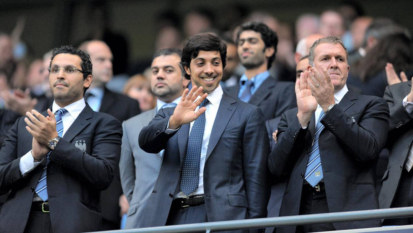 Manchester city owner Sheikh Mansour bin Zayed Al Nahyan (C) looks on during the English Premier League football match against Liverpool at The City of Manchester stadium, Manchester, north-west England on August 23, 2010. AFP PHOTO/ANDREW YATES.  FOR  EDITORIAL USE Additional licence required for any commercial/promotional use or use on TV or internet (except identical online version of newspaper) of Premier League/Football League photos. Tel DataCo +44 207 2981656. Do not alter/modify photo (Photo by ANDREW YATES / AFP)