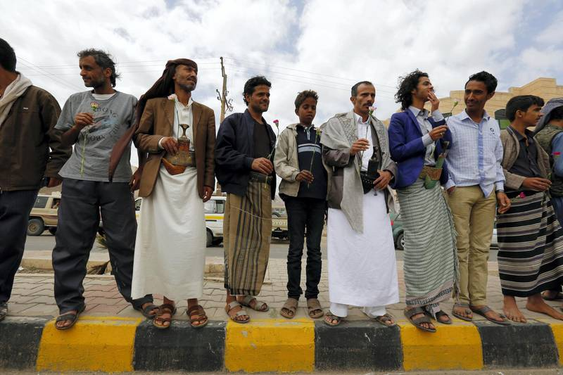 epa05242647 Baha'i Faith members hold flowers during a protest against the trial of member of the Baha'i Faith Hamed Haydara, outside the state security court in Sana?a, Yemen, 03 April 2016. According to reports, Yemeni authorities have indicted Hamed Haydara, a Yemeni national who was detained in December 2013 accused of being a spy for Israel and converting Muslims to the Baha'i Faith.  EPA/YAHYA ARHAB *** Local Caption *** 52682110