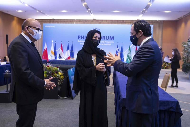 Bahrain's Foreign Affairs Minister Abdullatif Al-Zayani (L), Reem Ebrahim Al-Hashimi, Emirati Minister of State for International Cooperation, (C) and Cypriot Foreign Affairs Minister  Nikos Christodoulides (R) speak on February 11, 2021, in Athens, during the Greek-hosted Philia Forum (Friendship Forum), with representatives from several Persian Gulf and East Mediterranean countries. Greece is hosting Foreign ministers and senior officials from Bahrain, Cyprus, Egypt, Jordan, Saudi Arabia, UAE, Iraq, and France for a meeting in Athens focused on a range of issues. / AFP / POOL / PETROS GIANNAKOURIS