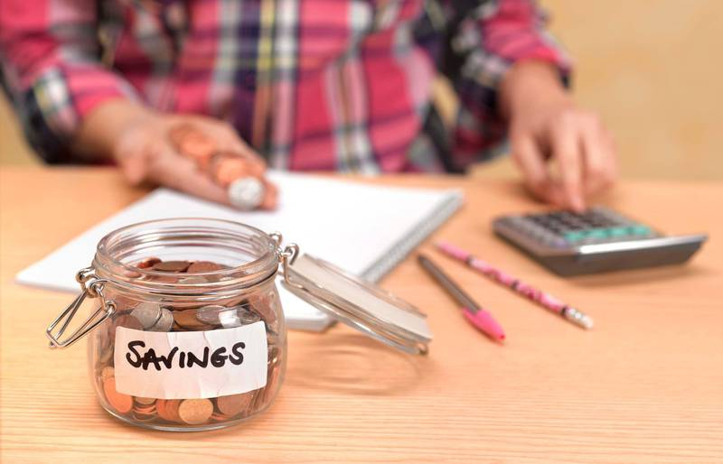 Teenager counting savings. Getty Images