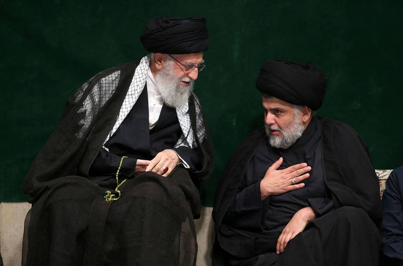 In this picture released by the official website of the office of the Iranian supreme leader, Supreme Leader Ayatollah Ali Khamenei, left, greets Iraqi Shiite cleric Muqtada al-Sadr during a mourning ceremony commemorating Ashoura, the death anniversary of Hussein, the grandson of Prophet Muhammad, in Tehran, Iran, Tuesday, Sept. 10, 2019. Shiite Muslims around the world are observing Ashoura, one of the most sacred religious holy days for their sect, which commemorates the death of Hussein, at the Battle of Karbala in present-day Iraq in the 7th century. (Office of the Iranian Supreme Leader via AP)