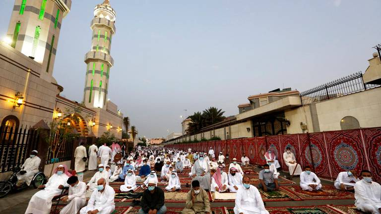 Muslims wearing masks and keeping social distancing to curb the spread of coronavirus outbreak, perform an Eid al-Fitr prayer marking the end of the holy fasting month of Ramadan at al-Mirabi Mosque in Jiddah, Saudi Arabia, Thursday, May 13, 2021. (AP Photo/Amr Nabil)