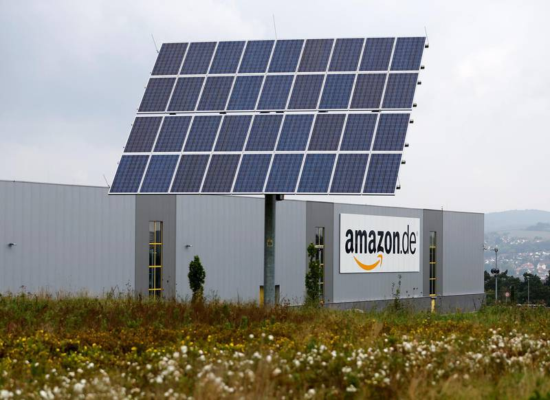 FILE PHOTO: Photovoltaic panels stand in front of the Amazon distribution centre in Bad Hersfeld September 22, 2014. REUTERS/Kai Pfaffenbach/File Photo