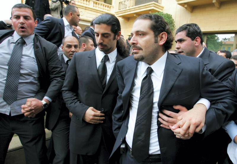 The son of Lebanon's slain former prime minister Rafiq Hariri, Saadeddine (R), and other family members leave their family home to join the funeral procession in Beirut 16 February 2005. Hariri's funeral cortege left his home to his final resting place in central Beirut accompanied by thousands of mourners amid a heavy security presence. Hariri, 60, was killed in a massive explosion in Beirut 14 February.  AFP PHOTO/RAMZI HAIDAR (Photo by RAMZI HAIDAR / AFP)
