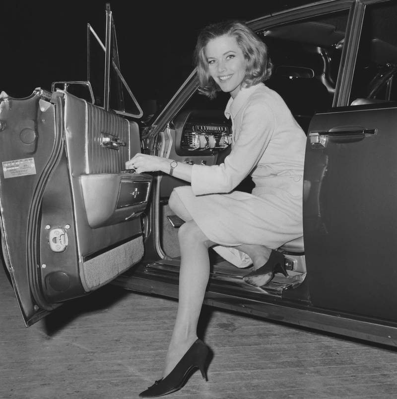 English Actress Honor Blackman smiles while coming out from a car, UK, 26th March 1964. (Photo by Larry Ellis/Daily Express/Hulton Archive/Getty Images)