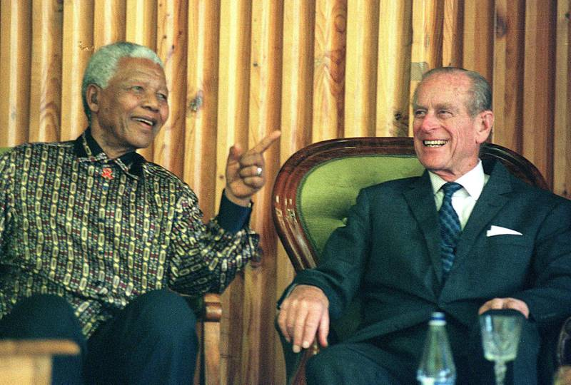 Former South African president Nelson Mandela (L) shares a light moment with the Duke of Edinburgh, Prince Phillip at Drakenstein Prison, Paarl about 50 kms outside of Cape Town 05 November 2000. The two men attended an awards ceremony for juvenile prisoners held under the auspices of the International Awards Association, a development programme for young people. (Photo by ANNA ZIEMINSKI / AFP)