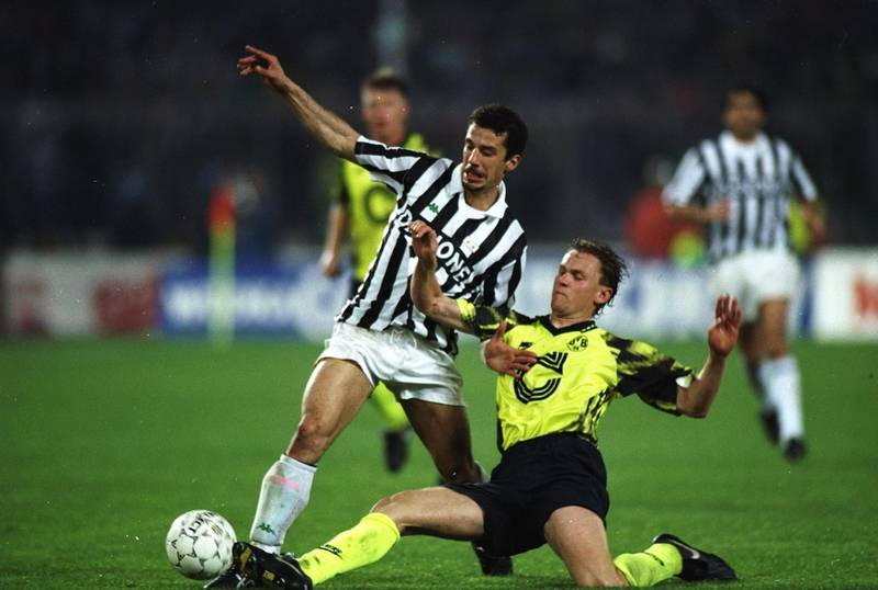 19 May 1993:  Gianluca Vialli of Juventus is tackled by Schmidt of Borussia Dortmund during the UEFA Cup final second leg at the Delle Alpi Stadium in Turin, Italy. Juventus won the match 3-0. \ Mandatory Credit: Shaun  Botterill/Allsport