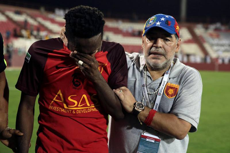 Soccer Football - Al Fujairah v Khor Fakkan - UAE First Division - Fujairah stadium, Fujairah, United Arab Emirates - April 27, 2018 - Al Fujairah's manager Diego Maradona consoles a player after a draw against Khor Fakkan and missing out the automatic promotion to the Arabian Gulf League. REUTERS/Christopher Pike