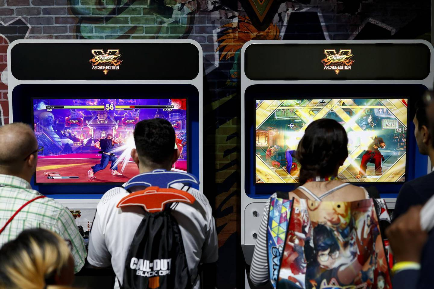 Attendees play the Capcom Co. Street Fighter V: Arcade Edition video game during the E3 Electronic Entertainment Expo in Los Angeles, California, U.S., in Los Angeles, California, U.S., on Wednesday, June 13, 2018. For three days, leading-edge companies, groundbreaking new technologies and never-before-seen products are showcased at E3. Photographer: Patrick T. Fallon/Bloomberg