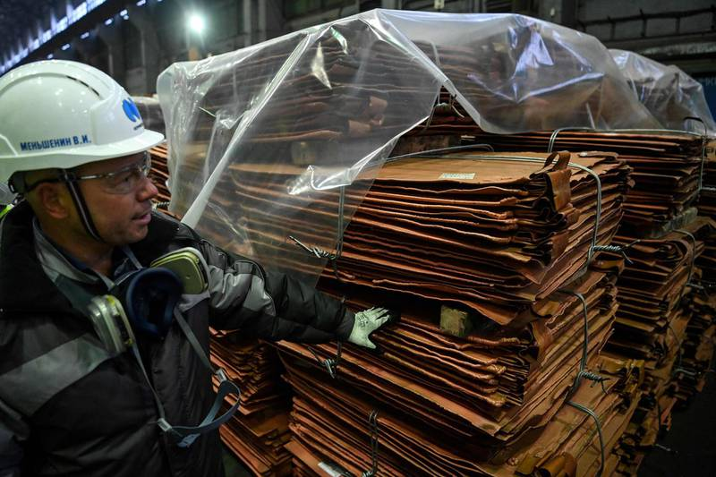 (FILES) In this file photo taken on February 25, 2021 A view shows copper sheets at Kola Mining and Metallurgical Company (Kola MMC), a unit of Russia's metals and mining company Nornickel, in the town of Monchegorsk in the Murmansk region. The price of a tonne of copper exceeded $10,000 on April 29, 2021, for the first time since February 2011 thanks to strong demand in China and the weak dollar. / AFP / Kirill KUDRYAVTSEV