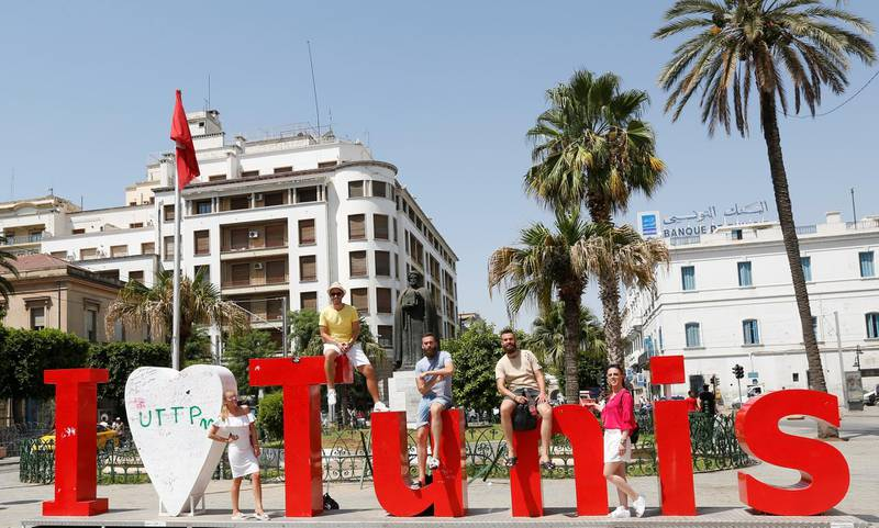 Tourists poses for picture in downtown Tunis, Tunisia, August 4, 2017.  REUTERS/Zoubeir Souissi