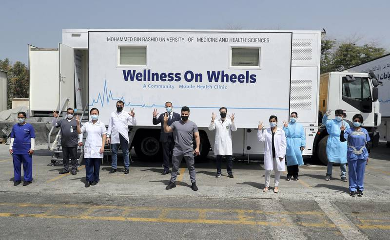 DUBAI, UNITED ARAB EMIRATES , March 11, 2021 – Staff members of  MBRU a community mobile health clinic posing for the photo near the Al Waha Community on Nad Al Hamar Road in Dubai. (Pawan Singh / The National) For News/Online/Instagram. Story by Nick Webster