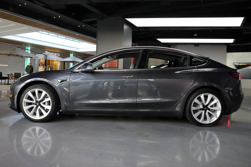 FILE PHOTO: A Tesla Model 3 is seen in a showroom in Los Angeles, California, U.S. January 12, 2018. REUTERS/Lucy Nicholson/File Photo