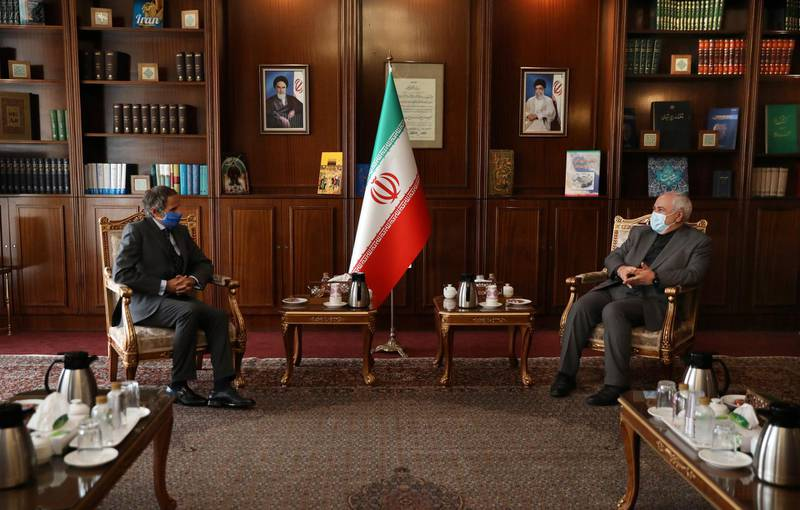 Director General of International Atomic Energy Agency, IAEA, Rafael Mariano Grossi, left, and Iran's Foreign Minister Mohammad Javad Zarif attend a meeting in Tehran, Iran, Tuesday, Aug. 25, 2020. Grossi arrived in Iran on Monday to press for access to sites where authorities are thought to have stored or used undeclared nuclear material. (AP Photo/Vahid Salemi)