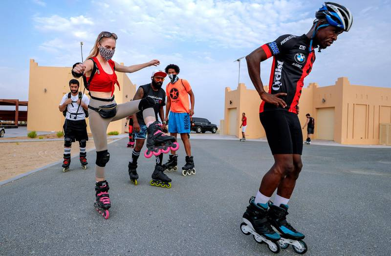 Abu Dhabi, United Arab Emirates, August 21, 2020.   The Madrollers skating group at the Al Wathba Bicycle Track do a  8 km. fun sprint.  The skating group has members from Dubai and Abu Dhabi.  They encourage safety and discipline on roller-skates, skateboard, long-board and bicycles.  --Rollerbladers do limbering exercises before going on the 8 km fun sprint. —  Liselotte of the Netherlands balances on a single leg before the sprint..Victor Besa /The NationalSection:  Photo ProjectReporter: