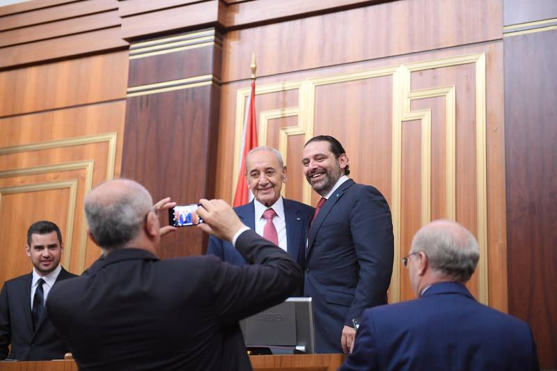 Lebanon's Finance Minister Ali Hassan Khalil takes photos of the parliamentary re-elected speaker Nabih Berri with outgoing Prime Minister Saad al-Hariri at the parliament in Beirut, Lebanon May 23, 2018. Lebanese Parliament/Handout via REUTERS ATTENTION EDITORS - THIS IMAGE WAS PROVIDED BY A THIRD PARTY