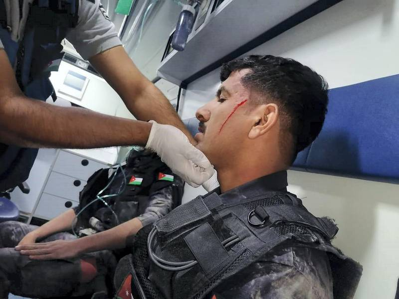Four members of a security force injured dealing with riots in the Naour area. Petra News Agency