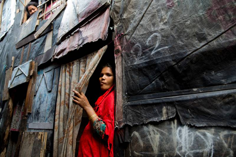 A Rohingya Muslim woman stands by the entrance to her shanty at a camp for refugees in New Delhi, India, Monday, Sept. 18, 2017. India's government said Monday that it has evidence there are extremists who pose a threat to the country's security among the Rohingya Muslims who have fled Myanmar and settled in many Indian cities. India's Supreme Court was hearing a petition filed on behalf of two Rohingya refugees challenging a government decision to deport the ethnic group from India. (AP Photo/Tsering Topgyal)