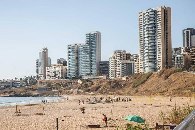 Residential apartment blocks stand near Remlet Al Bayda public beach in Beirut, Lebanon, on Saturday, July 28, 2018. Lebanon'sbanks are paying the highest interest rates on deposits in almost nine years as lenders seek to shore up their capital to cope with political uncertainty and the high borrowing needs of the government. Photographer: SimaDiab/Bloomberg