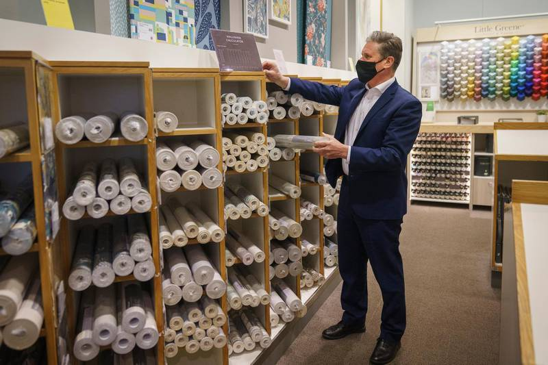MANCHESTER, ENGLAND - APRIL 29: Labour Party leader Sir Keir Starmer browses through the wallpaper section at John Lewis & Partners department store at the Intu Trafford Centre on April 29, 2021 in Manchester, England. The Labour Leader is in the area to campaign in the Greater Manchester Mayoral and local elections.  (Photo by Christopher Furlong/Getty Images)