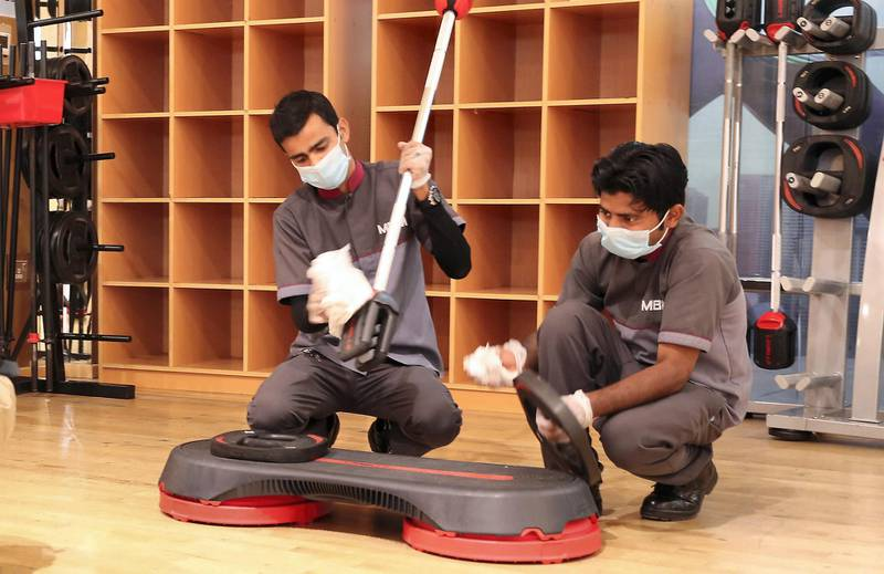 ABU DHABI , UNITED ARAB EMIRATES , March 12 – 2020 :- Cleaning staff sanitising the exercise equipment's as a preventive measure against coronavirus in the group exercise studio at the Abu Dhabi Country Club in Abu Dhabi.  (Pawan Singh / The National) For News/Online. Story by Haneen