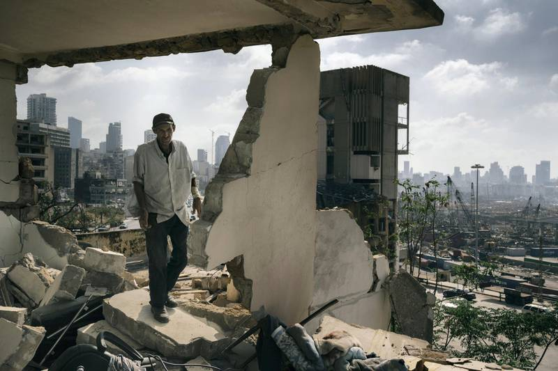 BEIRUT, LEBANON - AUGUST 14: Abdullah walks in the ruins of his former house. Since the day of the explosion he is squatting in the damaged building were he once lived with his family, with no water or electricity. An estimated 300,000 people lost their homes in after the blast. (Photo by Lorenzo Tugnoli/ Contrasto for The Washington Post)