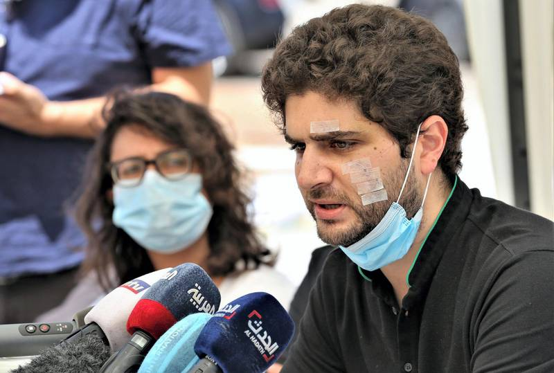 Mandatory Credit: Photo by NABIL MOUNZER/EPA-EFE/Shutterstock (10744412g) Lebanese Sarah Jaafar (L) and Paul Najjar (R) speak on their behalf and on behalf of the martyrs and injured in the port explosion on August 04, during a press conference under a tent in front of the site of the port explosion, Beirut, Lebanon, 14 August 2020. They demanded that the UN security council appoints an international investigation and international prosecution and punishment of this crime. According to the Lebanese Health Ministry, at least 160 people were killed, and more than 6,000 injured in the Beirut blast that devastated the port area on 04 August and believed to have been caused by an estimated 2,750 tons of ammonium nitrate stored in a warehouse. Press conference of victims of Beirut Port explosion, Lebanon - 14 Aug 2020