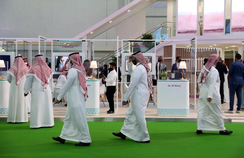 Visitors at the Saudi Arabia stand during the Arabian Travel Market held at Dubai World Trade Centre in Dubai on May 16,2021. Pawan Singh / The National. Story by Deena