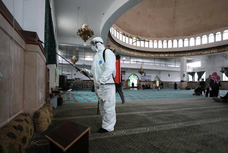 A volunteer from the Violet organisation disinfects a mosque in Syria's northwestern city of Idlib on April 25, 2020, from coronavirus (COVID-19) during the Muslim holy fasting month of Ramadan. (Photo by OMAR HAJ KADOUR / AFP)