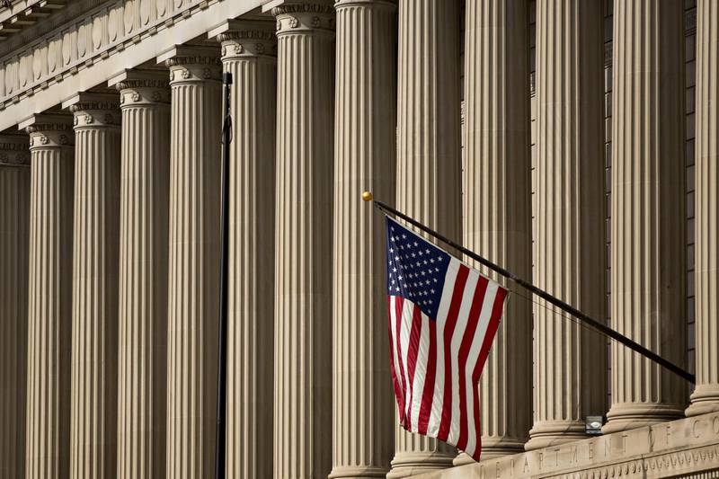 An American flag flies outside the U.S. Department of Commerce headquarters in Washington, D.C., U.S., on Friday, June 1, 2018. The Trump administration this week announced it is imposing tariffs on steel and aluminum imported from the European Union, Canada and Mexico to help protect America's manufacturing base the Commerce secretary said. Photographer: Andrew Harrer/Bloomberg