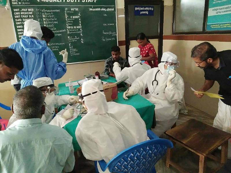Medical personnel wearing protective suits check patients at the Medical College hospital in Kozhikode on May 21, 2018. A deadly virus carried mainly by fruit bats has killed at least three people in southern India, sparking a statewide health alert May 21. Eight other deaths in the state of Kerala are being investigated for possible links to the Nipah virus, which has a 70 percent mortality rate.  / AFP / -