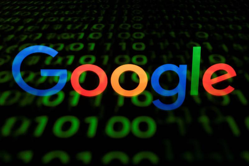 (FILES) This file photo taken on April 29, 2018 shows the Google logo displayed on a screen and reflected on a tablet in Paris. - Google said on August 23, 2018, it blocked YouTube channels and other accounts over a misinformation campaign linked to Iran, on the heels of similar moves by Facebook and Twitter. Google said that working with the cybersecurity firm FireEye, it linked the accounts to the Islamic Republic of Iran Broadcasting as part of an effort dating to at least January 2017. (Photo by Lionel BONAVENTURE / AFP)