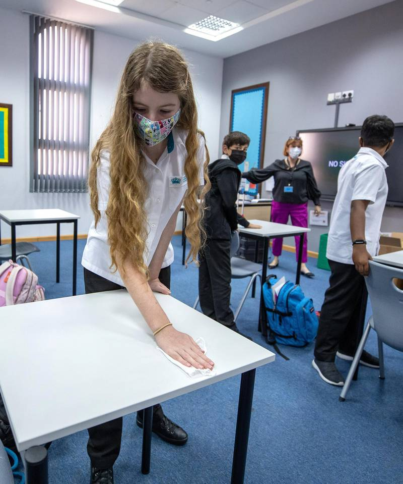 Abu Dhabi, United Arab Emirates, March 1, 2021.  Schools look back at one year of distance learning.  British International School Abu Dhabi.  A pupil sanitizes her desk before the class starts.Victor Besa / The NationalSection:  NAReporter:  Anam Rizvi