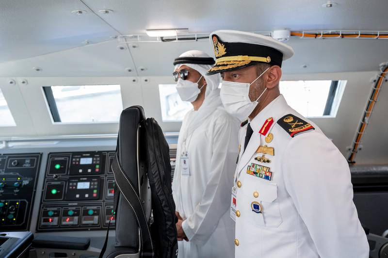 ABU DHABI, UNITED ARAB EMIRATES - February 23, 2021: Rear Admiral Pilot HH Sheikh Saeed bin Hamdan bin Mohamed Al Nahyan, Commander of the UAE Naval Forces (R) and HE Mohamed Mubarak Al Mazrouei, Undersecretary of the Crown Prince Court of Abu Dhabi (L), tour the 2021 Naval Defence and Maritime Security Exhibition (NAVDEX), at ADNEC.   ( Hamad Al Kaabi / Ministry of Presidential Affairs ) ---