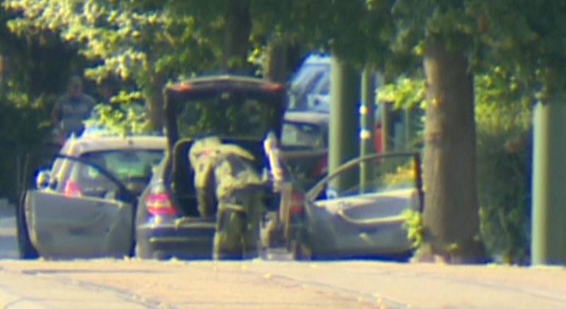 A bomb disposal expert is seen searching a car in the Brussels' commune of Woluwe St Pierre, June 30, 2018. RTL Television. TV Picture taken June 30, 2018.  Reuters TV via REUTERS  TV.  NO RESALES. NO ARCHIVE. BELGIUM OUT. BELGIUM OUT.