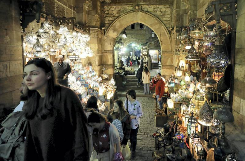 """Tourists are seen in a popular tourist area named """"Khan el-Khalili"""" in the al-Hussein and Al-Azhar districts in old Islamic Cairo, Egypt December 30, 2018. REUTERS/Mohamed Abd El Ghany"""