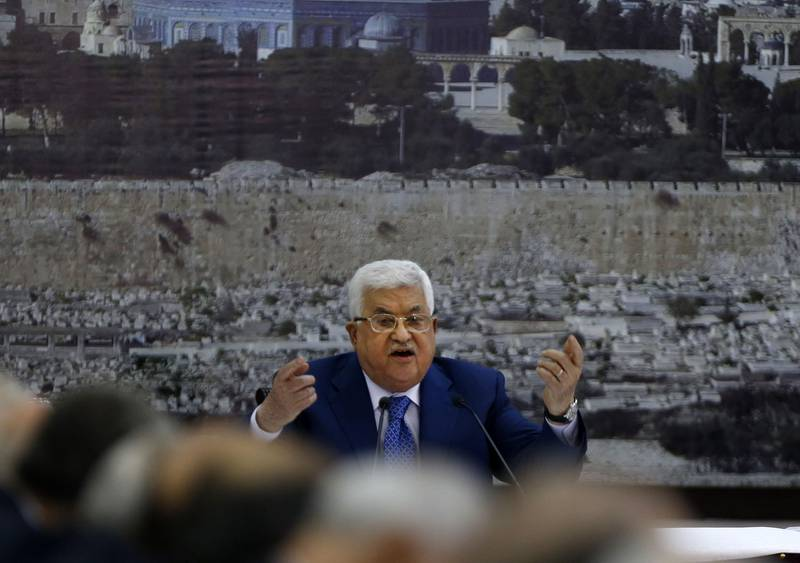 """Palestinian Authority President Mahmud Abbas adresses the Palestinian leadership in the West Bank city of Ramallah on May 14, 2018.  Abbas condemned Israeli """"massacres"""" along the Gaza Strip border after Israeli forces killed 52 Palestinians during clashes and protests coinciding with the opening of the US embassy in Jerusalem. Abbas, who declared three days of mourning, also said """"the US is no longer a mediator in the Middle East,"""" adding the new embassy is tantamount to """"a new American settler outpost"""" in Jerusalem.  / AFP / ABBAS MOMANI"""