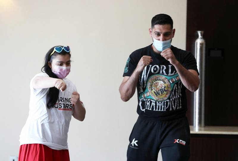 DUBAI, UNITED ARAB EMIRATES , December 28 – 2020 :- Amir Khan, British professional boxer posing for the photo with Anoushka Tandon during the Rising Stars (people with determination) event held at the Fairmont The Palm hotel on Palm Jumeirah in Dubai. ( Pawan Singh / The National ) For News/Online/Instagram. Story by Kelly