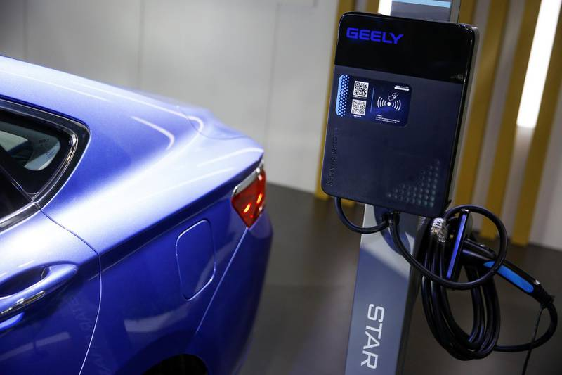 The electric car charging station at the stall of the Geely automobile maker is seen at the IEEV New Energy Vehicles Exhibition in Beijing, China October 18, 2018.  Picture taken October 18, 2018.   REUTERS/Thomas Peter