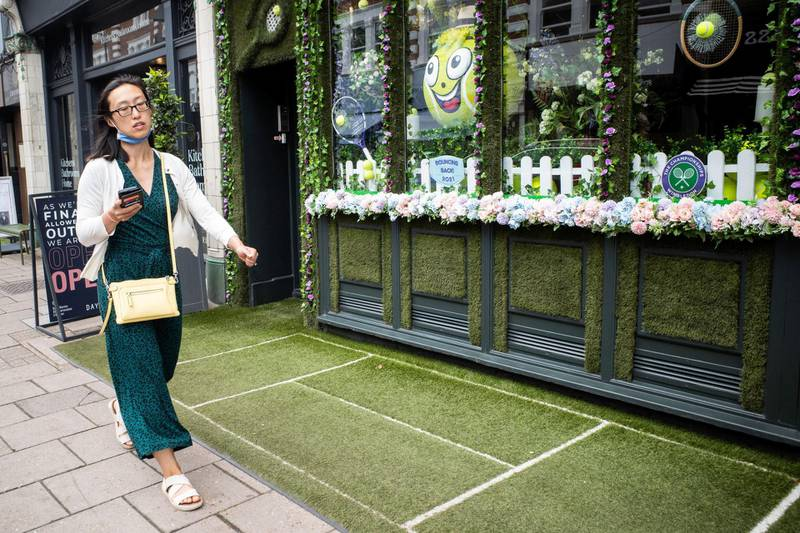 In the run up to the Wimbledon tennis championship reporter Tim Stickings and I visited and interviewed locals to guage the feeling ahead of the competition. Many local businesses create elaborate window displays to celebrate the tennis, one of the best we saw was at the Thai Tho restaurant complete with signed tennis ball shrine watched over by a Buddha statue.