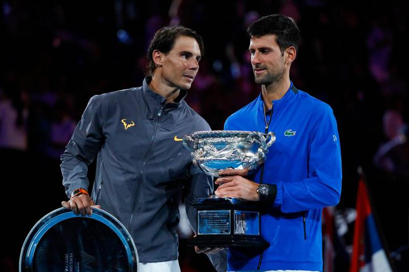 Spain's Rafael Nadal congratulates Serbia's Novak Djokovic (R) during the presentation ceremony after the men's singles final on day 14 of the Australian Open tennis tournament in Melbourne on January 27, 2019. (Photo by DAVID GRAY / AFP) / -- IMAGE RESTRICTED TO EDITORIAL USE - STRICTLY NO COMMERCIAL USE --