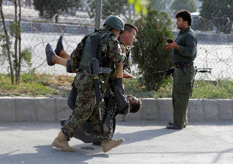 ATTENTION EDITORS - VISUAL COVERAGE OF SCENES OF INJURY OR DEATH  Afghan soldiers carry an injured man after a blast in Kabul, Afghanistan July 22, 2018.REUTERS/Omar Sobhani