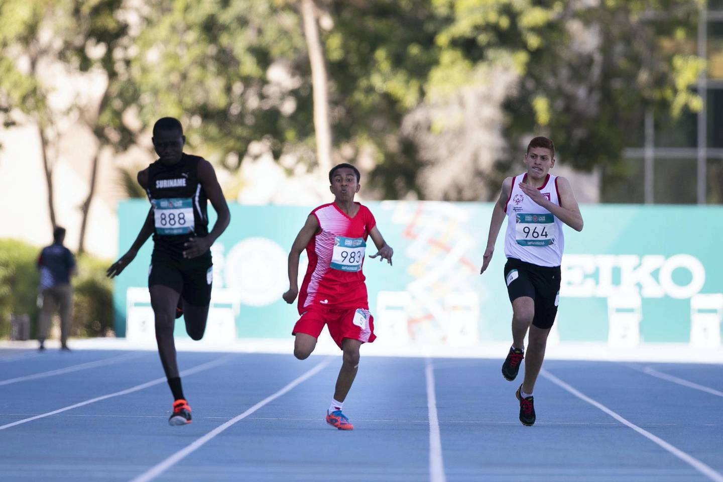 DUBAI, UNITED ARAB EMIRATES - March 19 2019.14 yo Emirati athlete ALI ALMESMARI places 4th at Special Olympics World Games athletics 100M race in Dubai Police Academy Stadium. (Photo by Reem Mohammed/The National)Reporter: Section:  NA