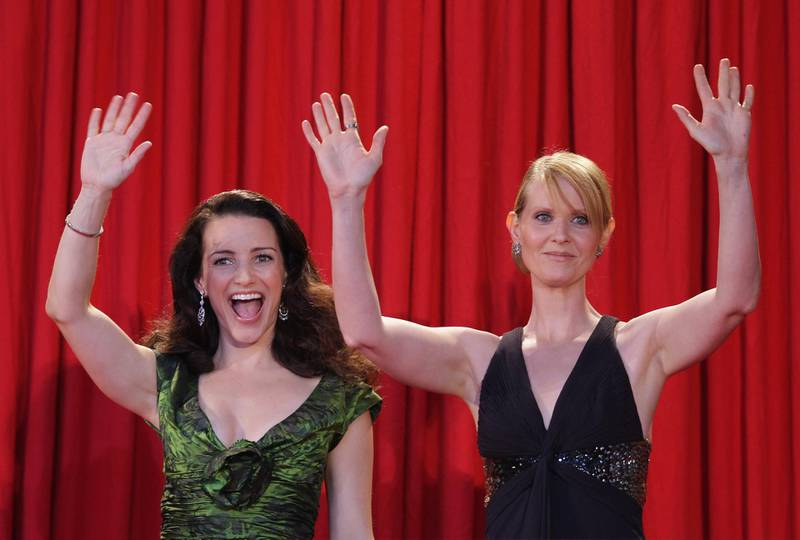 BERLIN - MAY 15:  (L-R) Actresses Kristin Davis and Cynthia Nixon wave on their arrival at the German premiere of 'Sex And The City' at the cinestar on May 15, 2008 in Berlin, Germany.  (Photo by Andreas Rentz/Getty Images)