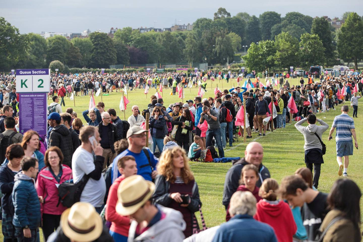 WIMBLEDON, ENGLAND - JULY 03: Tennis fans wait in line at the public queueing zone outside the All England Tennis Club on July 3, 2017 in Wimbledon, England. Thousands of tennis fans queue for tickets as the first day of the Wimbledon Tennis Championships gets underway. (Photo by Jack Taylor/Getty Images)