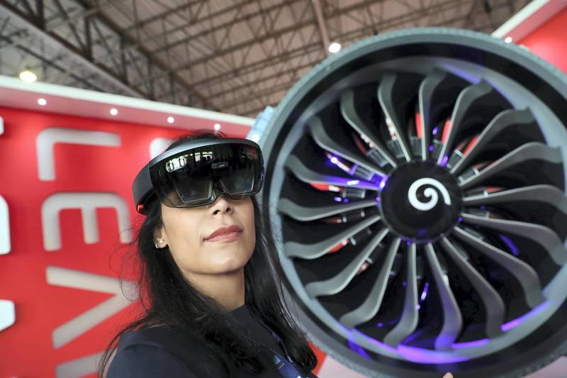 Dubai, United Arab Emirates - November 14th, 2017: Fatma Al-Suwaidan at the CFM stand where she uses interactive glasses to find out info at the Dubai airshow. Tuesday, November 14th, 2017 at Al Maktoum Airport, Dubai. Chris Whiteoak / The National