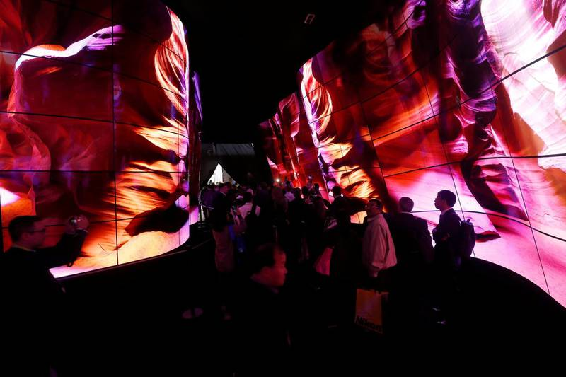 Attendees enter the LG Electronics booth through a tunnel of OLED televisions at the Las Vegas Convention Center during the 2018 CES in Las Vegas, Nevada, U.S. January 9, 2018. REUTERS/Steve Marcus